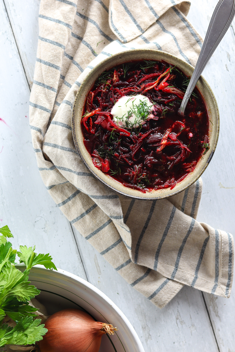 This classic vegetarian borscht soup recipe is a traditional Ukrainian soup made of beets, celery, cabbage, dill, onions, carrots and more healthy ingredients.
