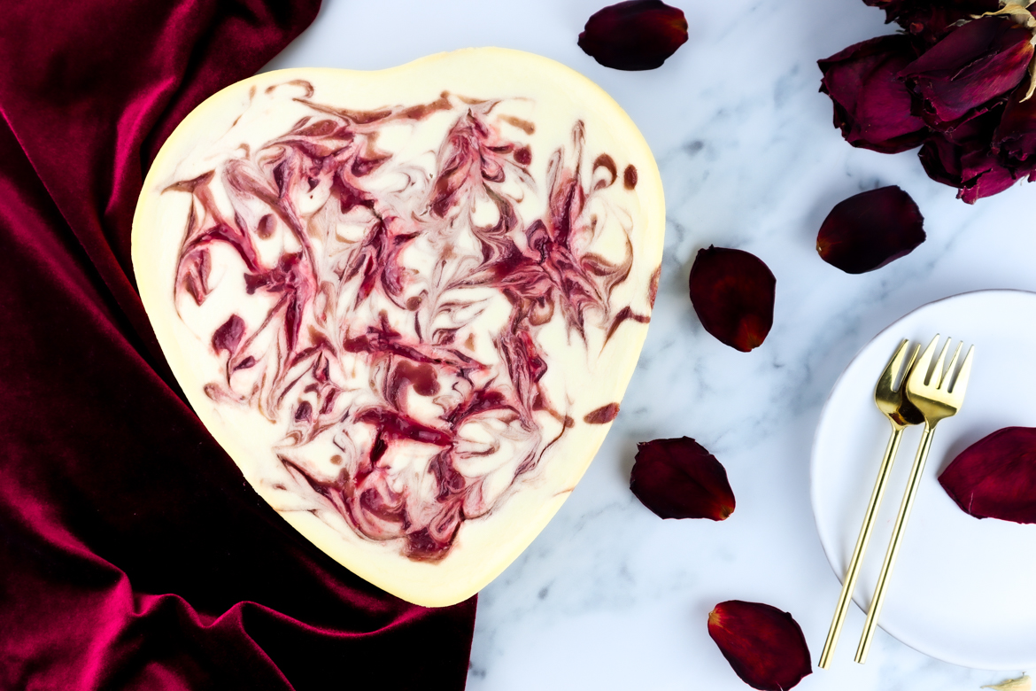 This is year's Valentine's Day we can all use extra love and sweets. With this white chocolate & raspberry swirl cheesecake you will make every heart beat faster