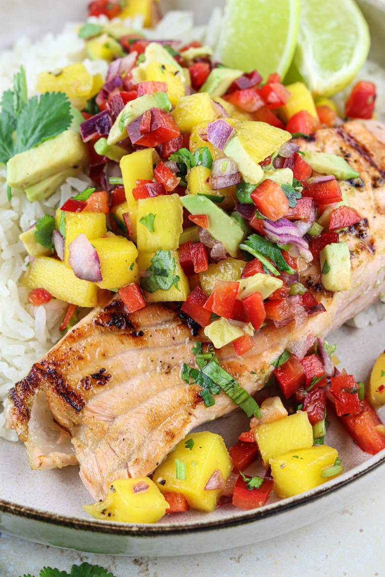 The tropical flavors of the smokey grilled salmon, juicy salad and sweet coconut rice will make you smile instantly!