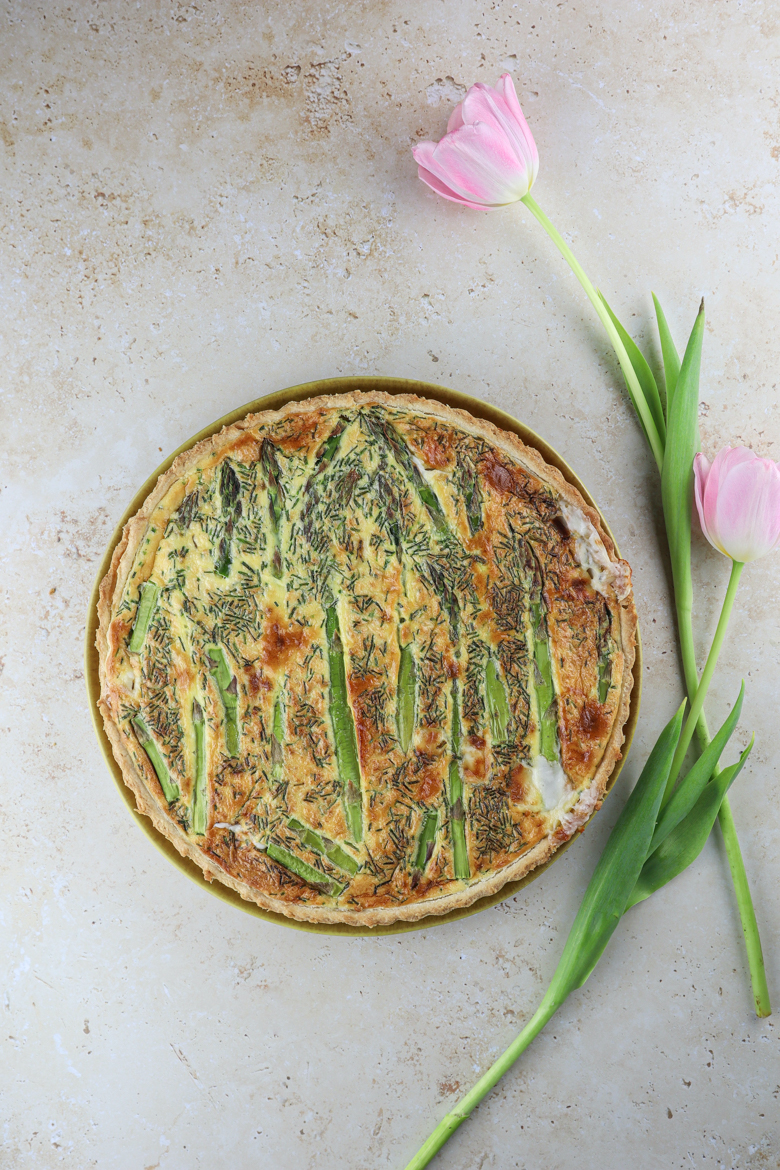 This easy spring quiche is made of a delicious homemade crust filled with tender and crisp asparagus, goat cheese and chives.