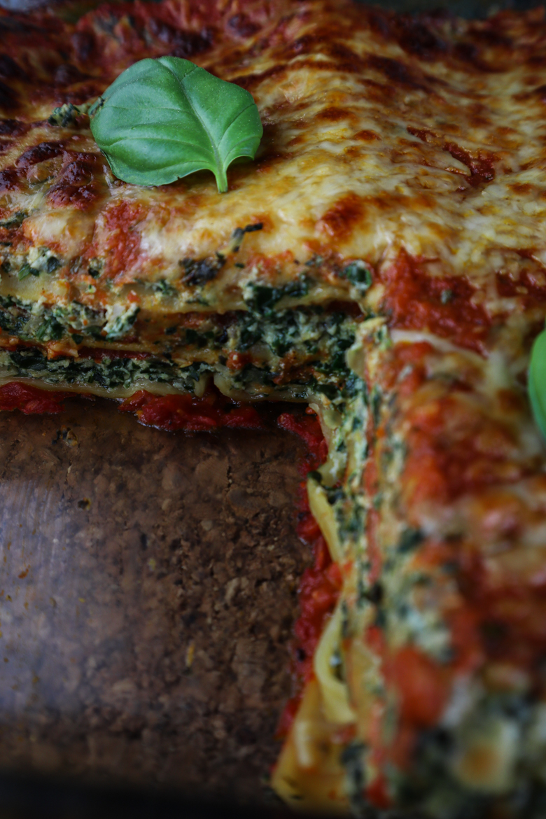 This healthy vegetarian lasagna includes lots of fresh spinach, roasted red peppe, jarred artichokes, ricotta and homemade tomato sauce..