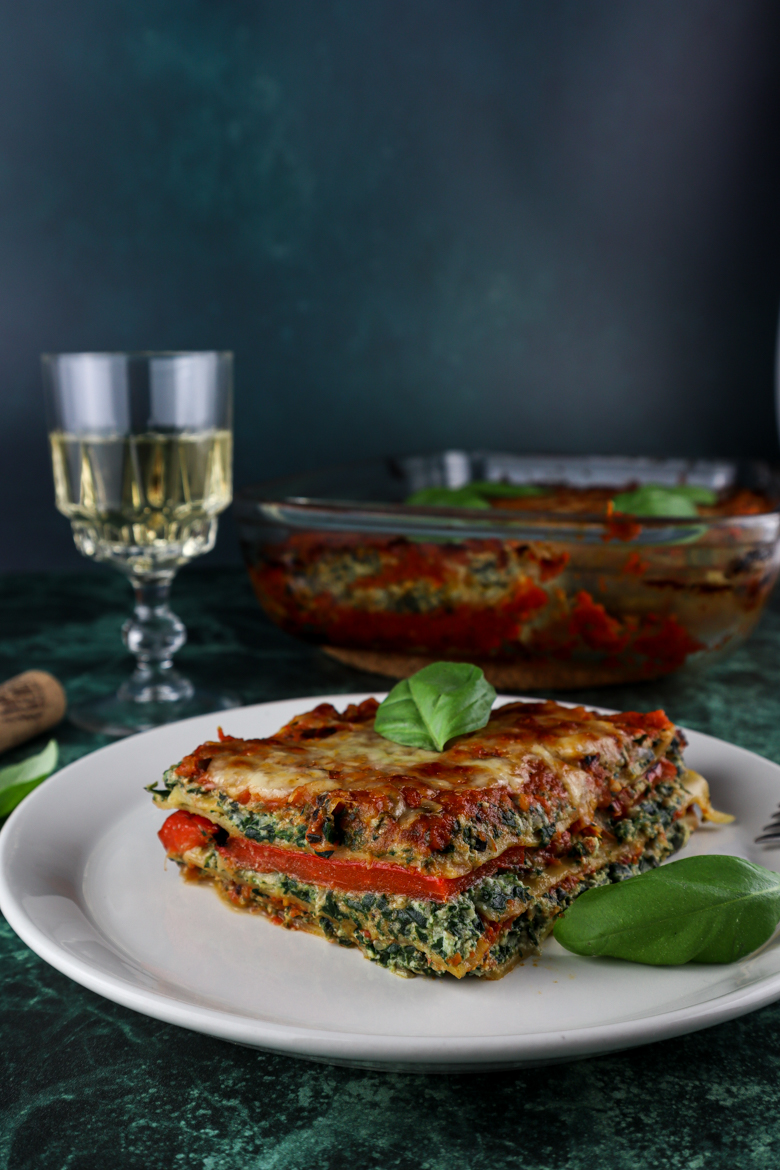 This healthy vegetarian lasagna includes lots of fresh spinach, roasted red pepper, jarred artichokes, ricotta and homemade tomato sauce..