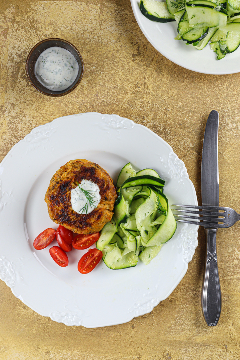 These sweet potato & chickpea burgers are vegan, protein rich, topped with a yogurt dill sauce and served with a fresh raw courgette salad.