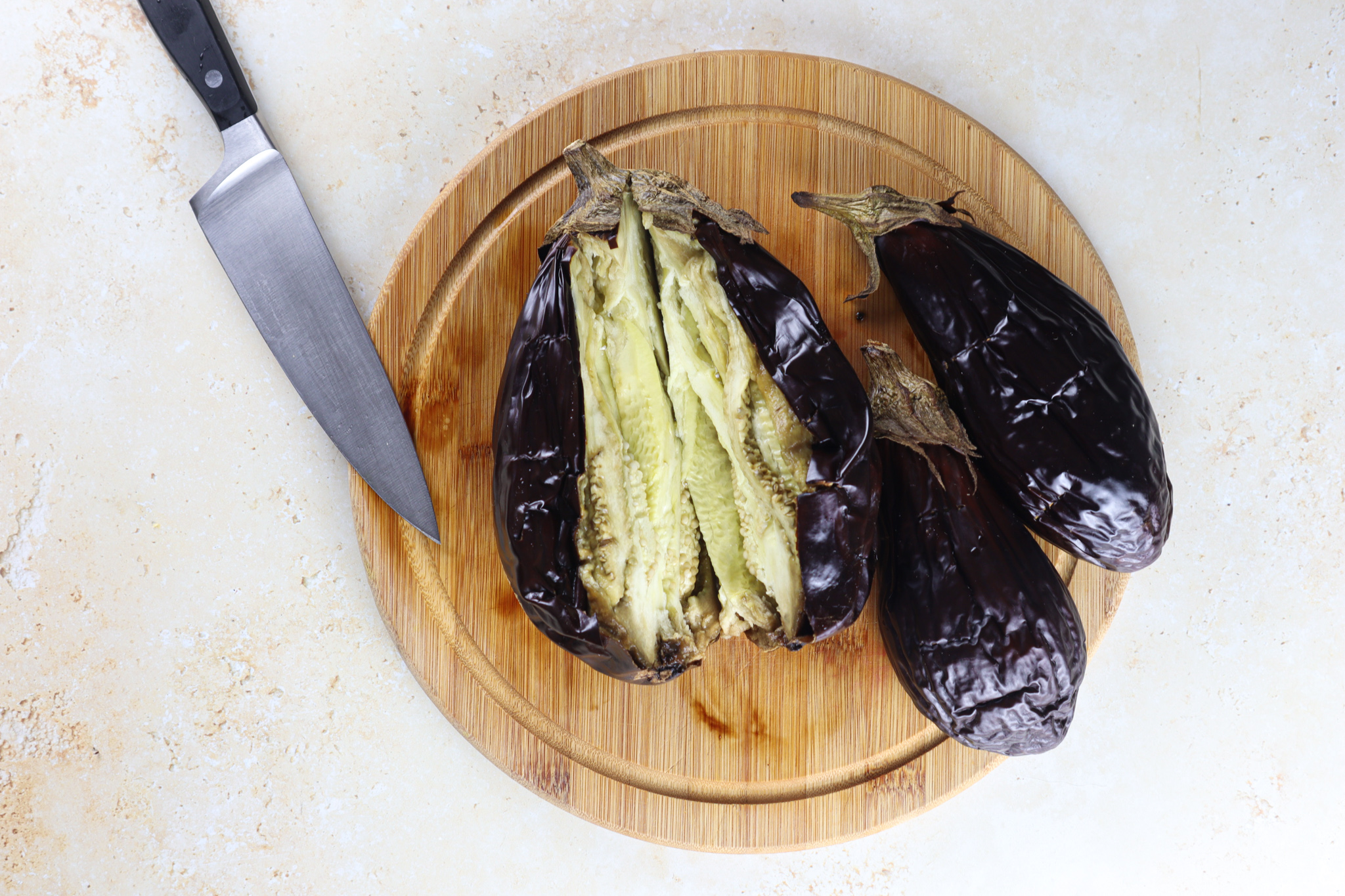 It almost looks like hummus and often served together, but baba ganoush calls for grilled or smoked eggplants instead of chickpeas.
