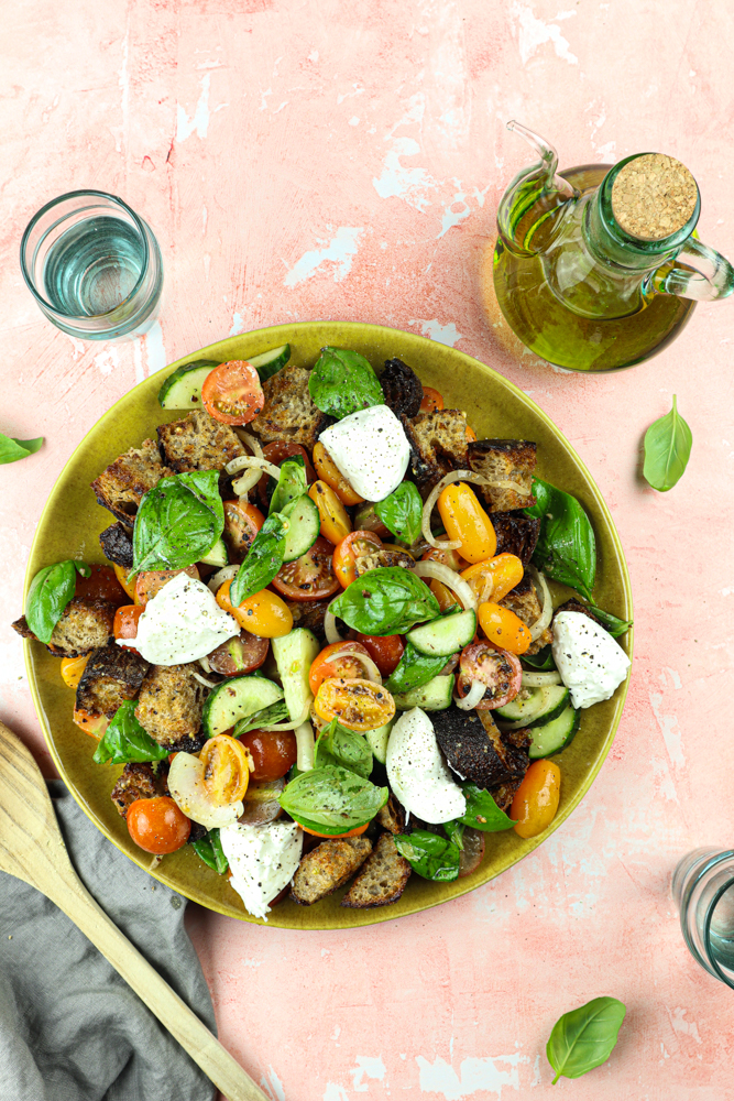 Panzanella is a classic Italian bread salad mixed with a tangy vinaigrette that gives old bread a delicious use. It has never tasted so good!